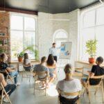 male speaker giving presentation hall university workshop audience conference hall 155003 17907 150x150 - Aktualności